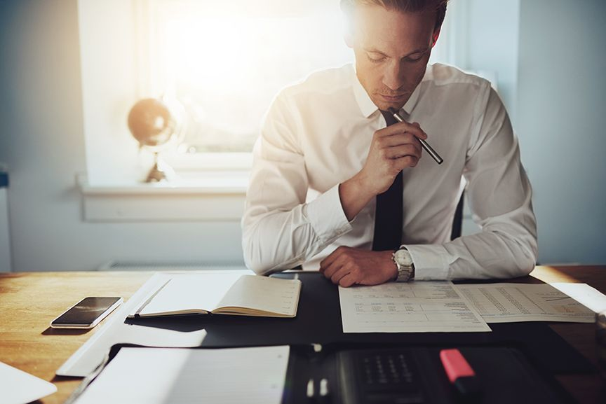 Reporting manager working on financial reports